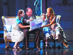 Hot off the press: Brigitta (Rachelle Weiss), Gretl (Ansie du Plessis) and Liesl von Trapp (Carmen Pretorius) examine the poster for their 1938 festival performance, with uncle Max Detweiler (James Borthwick). PHOTOGRAPH BY PAT BROMILOW-DOWNING.